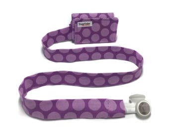 Purple polka dot TuneTube.  Earbud cord organizer for iPhone or iPod.  Cord keeper.  Earbud holder.  Earbud case.