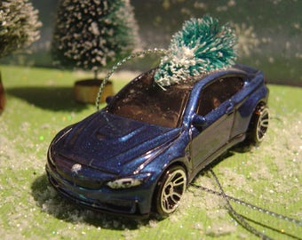 BMW M4 blue car with Christmas tree ornament