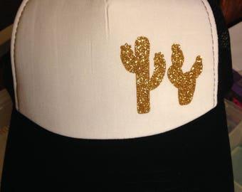 Black, white, and gold cactus women's trucker hat