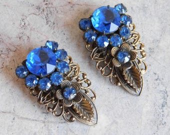 Pair of Vintage Gray Kingsburg NY Blue Rhinestone Dress Clips - Brass Filigree w/ Deep Blue Prong-Set Faceted Glass Stones - 1920s to 1940s