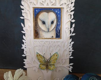 A block painting called 'The Owl and Butterfly' by Amanda Clark. Acrylic painting with paper cut design.
