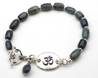 Blue om bracelet, boho Tibetan Zen jewelry, kyanite beads, semiprecious stone, 7 3/4 inches long
