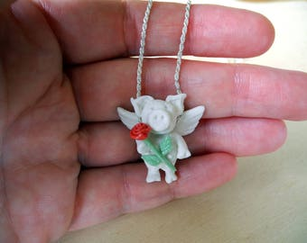 Flying pig in white porcelain with a red rose - pendant on a sterling silver rope chain - necklace with piggy