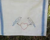 Hand embroidered bluebirds in love tea towel