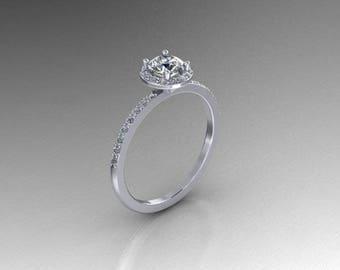 Elegant platinum half round cut diamond halo engagement ring .