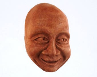 """Small """"Chuckle"""" Cement Face for the Wall"""