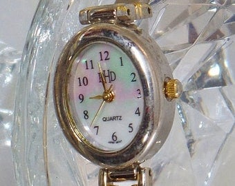 SALE Vintage Mother of Pearl Shell Ladies Watch. PHD. Mother of Pearl Face and Band Wrist Watch. Silver and Gold Women's Watch.