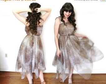 ON SALE 1970s Dress / 70s Handkerchief Hem Leopard Print Dress