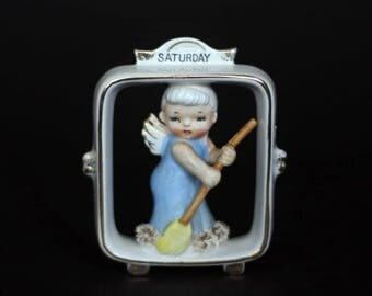 vintage lefton saturday's child figurine