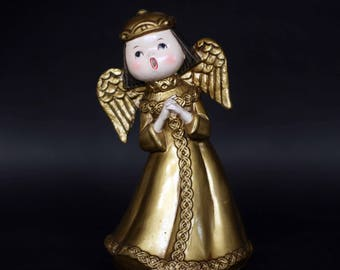 vintage golden musical angel plays silent night