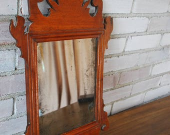 Mottled antique hand carved wood mirror