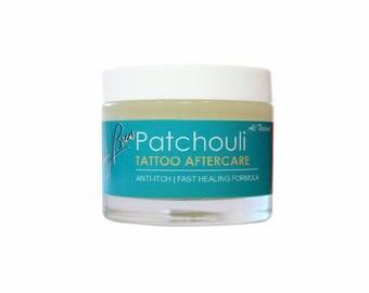 Beauty Brew Tattoo Aftercare Balm. Anti-itch & fast healing formula. W/ Patchouli Oil.  Net Wt. 2.3 oz.