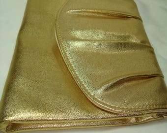 1980s Golden Pleated Clutch Bag.