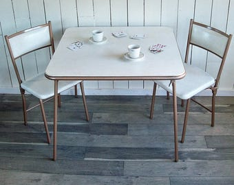 "Mid Century Modern Cosco Gatefold Folding Table and Two Folding Chairs ""White Vinyl & Bronze Steel"""
