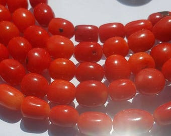 Red Coral drum shaped beads-Strand 15 inches long.