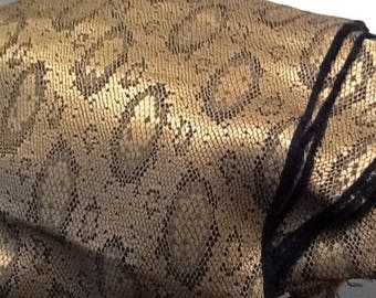 Reptile print silky fabric black and gold
