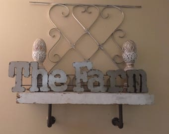 Metal The Farm sign