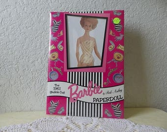 The 1961 Bubble Cut Barbie Paper Doll by Peck Aubry, Unopened 1994.