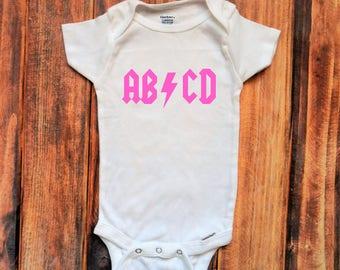 ABCD Pink Onesie