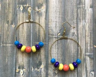 Orange yellow and blue beaded dangle earrings
