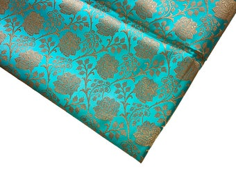 15% off on One yard of Indian brocade fabric in Turquoise blue in a flower and vine pattern