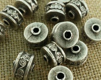 Silver barrel beads