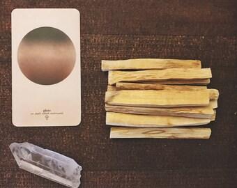 PALO SANTO STICKS, bundled holy wood sticks with quartz crystal point gemstone