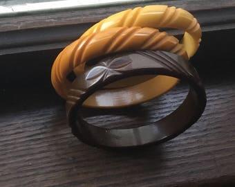 3 carved Bakelite bangel bracelets