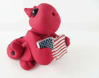 Polymer clay red baby dragon with the US flag