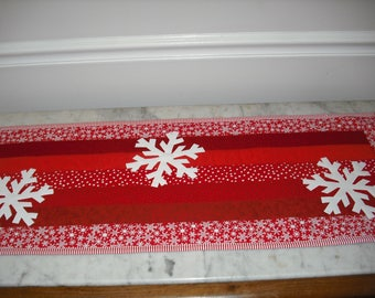 Christmas Winter red snowflake Table runner . 14 1/2 inches wide by 40 inches long.  Cotton. Polyester batting. Machine quilted.