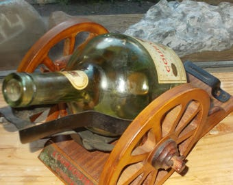 1960's Courvoisier  cognac bottle with  wooden canon with wheels rare piece.. Napoleon 's choice of drink!