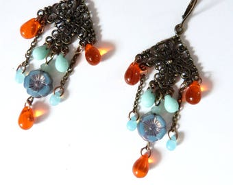 Boho style earring with drop glass beads and flowers in blue and orange.