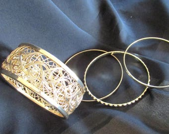 Gold tone metal cuff and bangles, basket weave cuff with three bangles