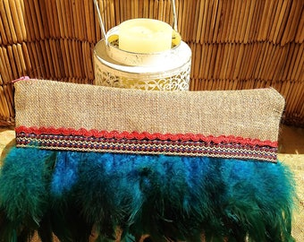 Burlap pouch and Rooster feathers