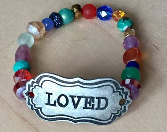One of a kind, handmade multi-colored beaded bracelet with silver metal LOVED plate