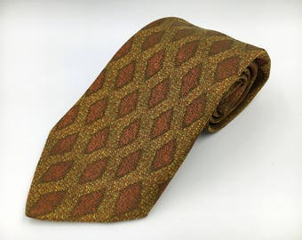 Vintage 1960s Wide Gold Polyester Silk Tie with Brown and Orange Pattern by Wembley