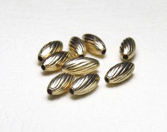 Perle Gold ribbed oval Filled 7mm x 3mm 2PC
