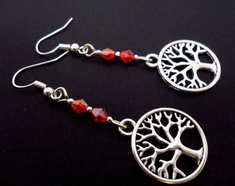 A pair of pretty tree of life red crystal  dangly earrings.