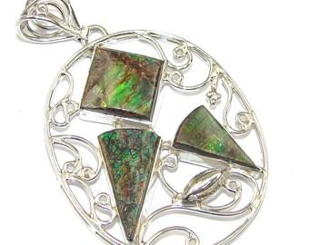 Ammolite Sterling Silver Pendant - weight 9.00g - dim L -2 1 4, W -1 1 2, t -1 8 inch - code 27-paz-15-11
