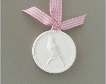 Round ceramic decorative items bird suspended from Pink Ribbon