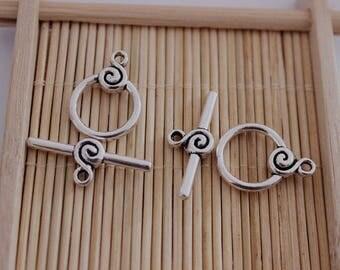 12 swirl silver metal toggle clasps