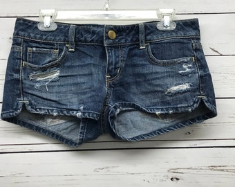 Vintage distressed blue jean denim womens shorts