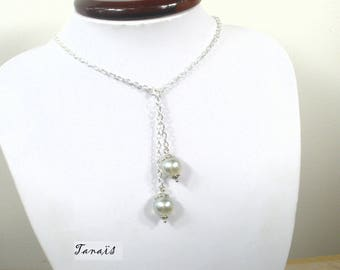 Necklace has tie around the neck TAN beads and silver wedding