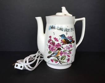 Electric whistling teapot