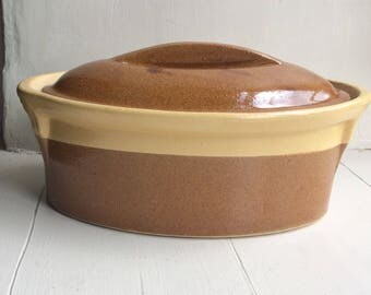 One of two vintage oval Casserole/Lidded Serving Dishes