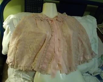 Pastel pink vintage bed jacket.  Lingerie.