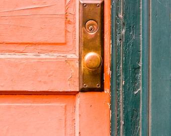 Orange Door with brass knob