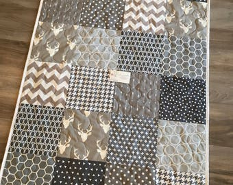 Grey and white deer and arrows gender neutral baby quilt