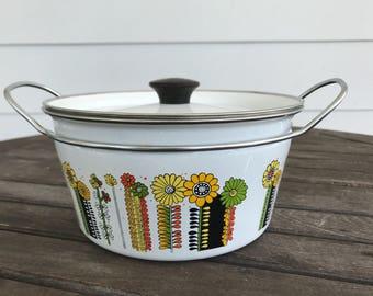 White lidded pot with retro flower design in black/orange/yellow