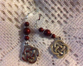 Bordeaux and sterling silver pierced earrings with Celtic knot charms.